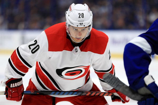 Carolina Hurricanes center Sebastian Aho looks on before a face off against the Tampa Bay Lightning