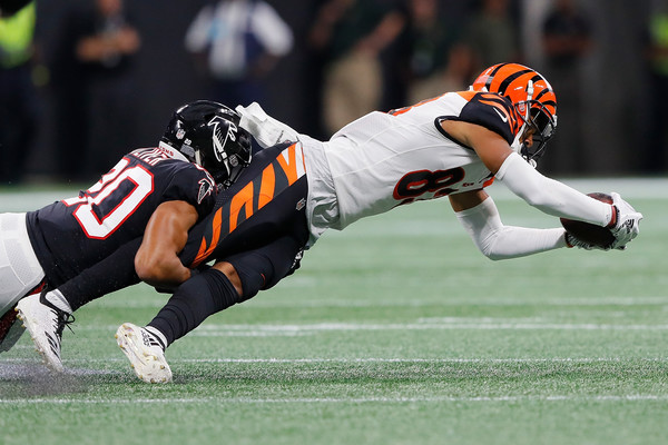 Cincinnati Bengals wide receiver Tyler Boyd is tackled by Isaiah Oliver against the Atlanta Falcons