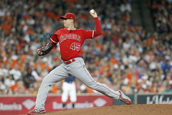 Former Los Angeles Angels pitcher Tyler Skaggs pitches against the Houston Astros