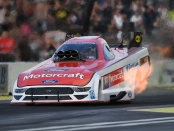 Funny Car pilot Bob Tasca III racing on Friday at the Magic Dry Organic Absorbent NHRA Northwest Nationals
