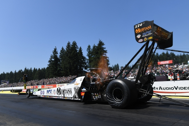 Top Fuel Dragster pilot Austin Prock racing on Sunday at the 2019 Magic Dry Organic Absorbent NHRA Northwest Nationals