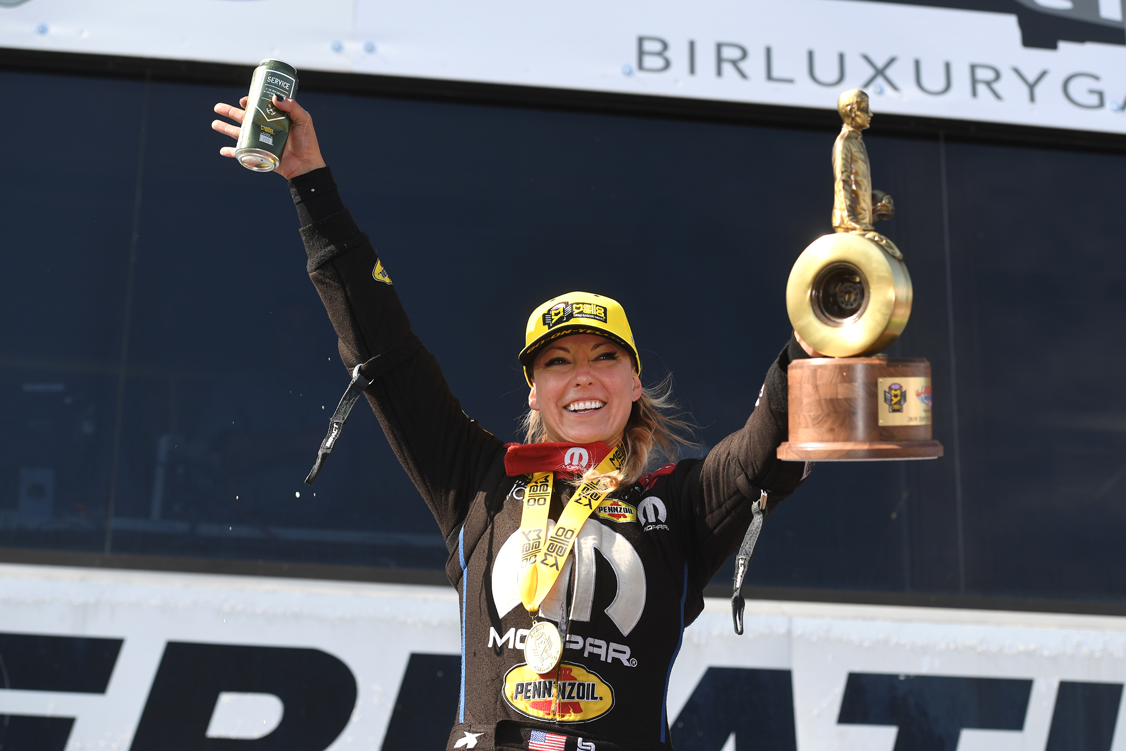 Top Fuel Dragster pilot Leah Pritchett with the Wally after winning the 2019 Lucas Oil NHRA Nationals