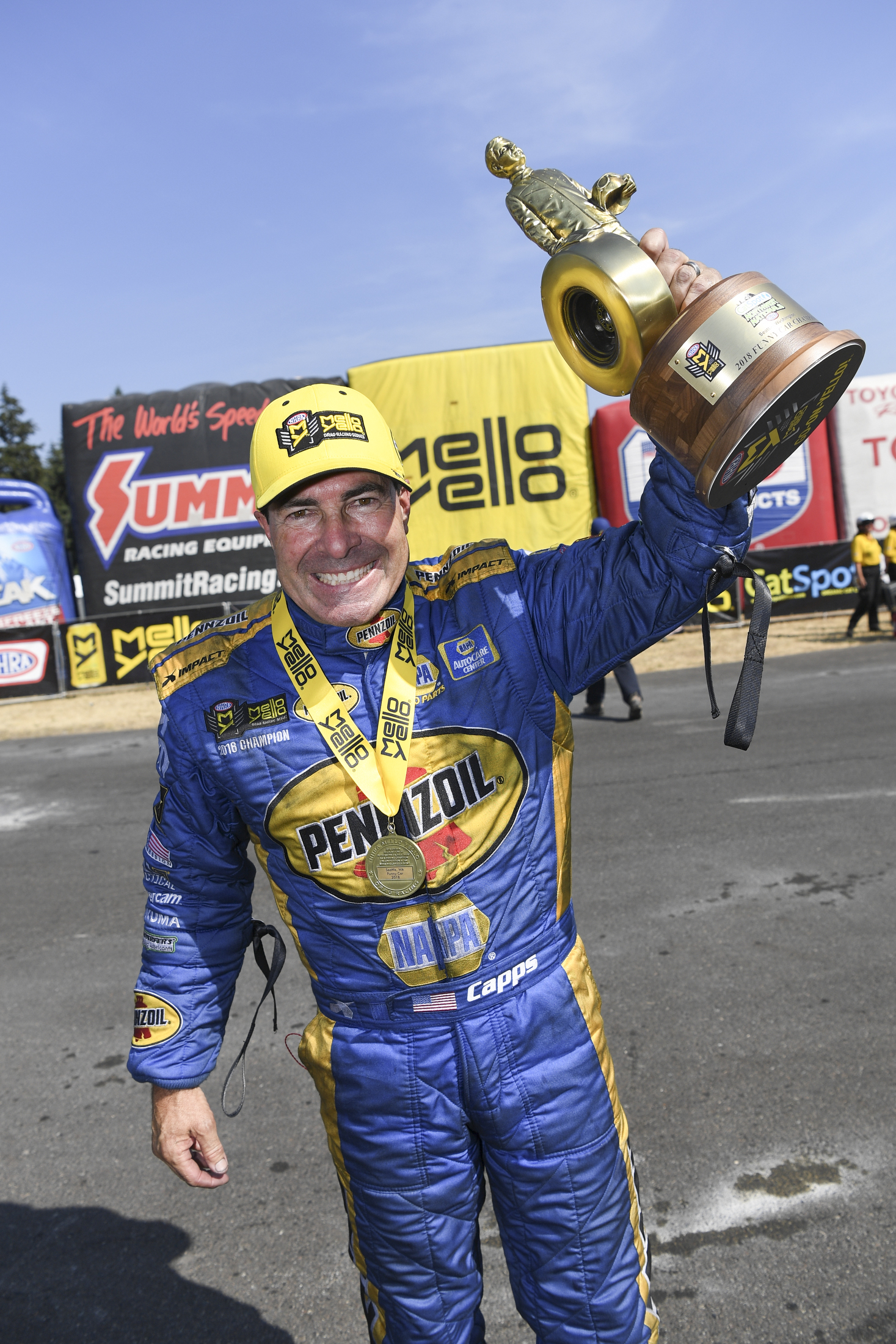 Funny Car pilot Ron Capps with the Wally after winning the 2018 CatSpot NHRA Northwest Nationals
