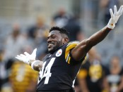 Former Pittsburgh Steelers wide receiver Antonio Brown joking around on the field before the preseason game against the Carolina Panthers