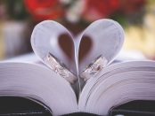Bible pages shaped as a heart and Wedding Rings