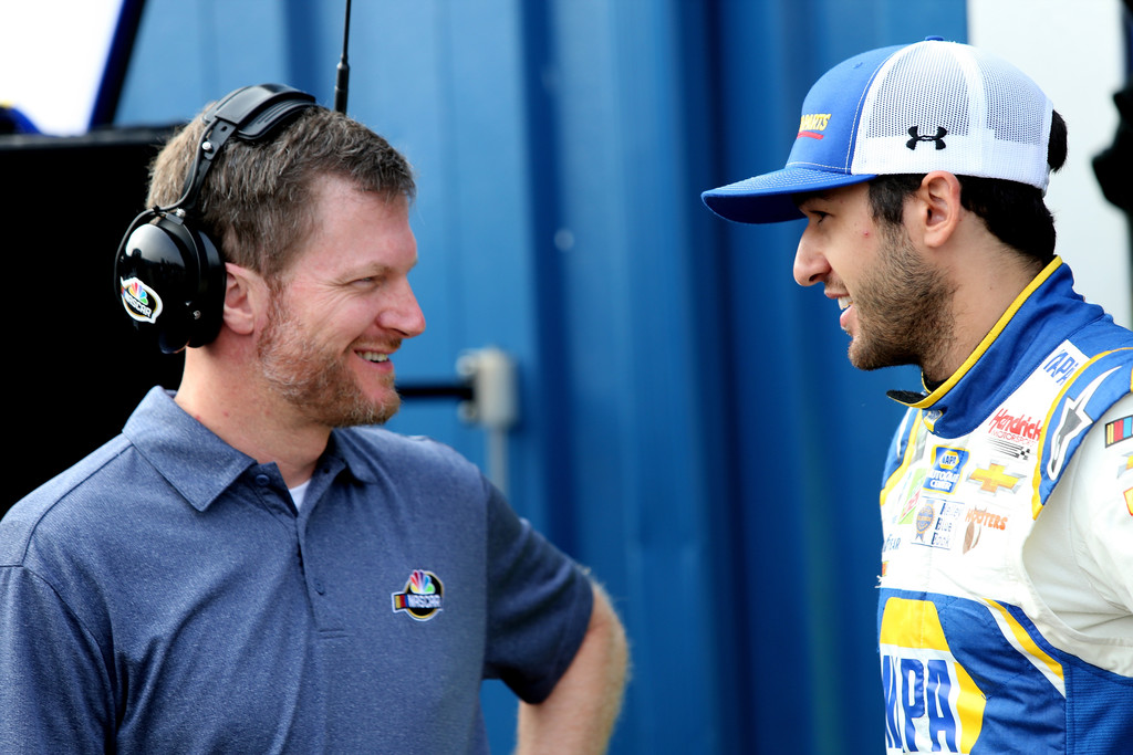 NASCAR great Dale Earnhardt Jr. talking to Cup Series driver Chase Elliott during practice for the Monster Energy NASCAR Cup Series Consumers Energy 400