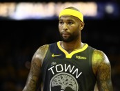 Former Golden State Warriors center DeMarcus Cousins reacts to a play against the Toronto Raptors in the 2019 NBA Finals