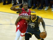 Former Golden State Warriors center DeMarcus Cousins goes to the basket while being defended by Serge Ibaka against the Toronto Raptors in the 2019 NBA Finals