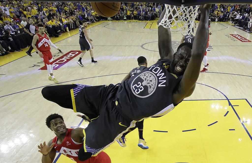 Golden State Warriors forward/center Draymond Green dunks the ball against the Toronto Raptors