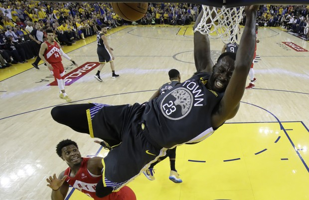 Golden State Warriors forward/center Draymond Green dunks the ball against the Toronto Raptors