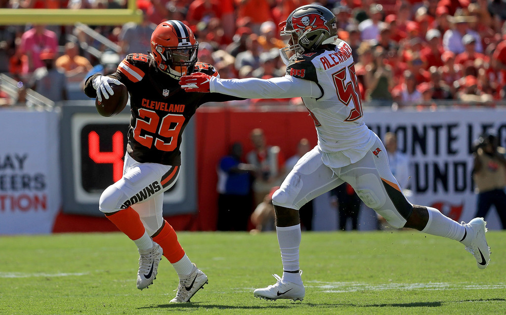 Former Cleveland Browns running back Duke Johnson attempts to run past Kwon Alexander against the San Francisco 49ers