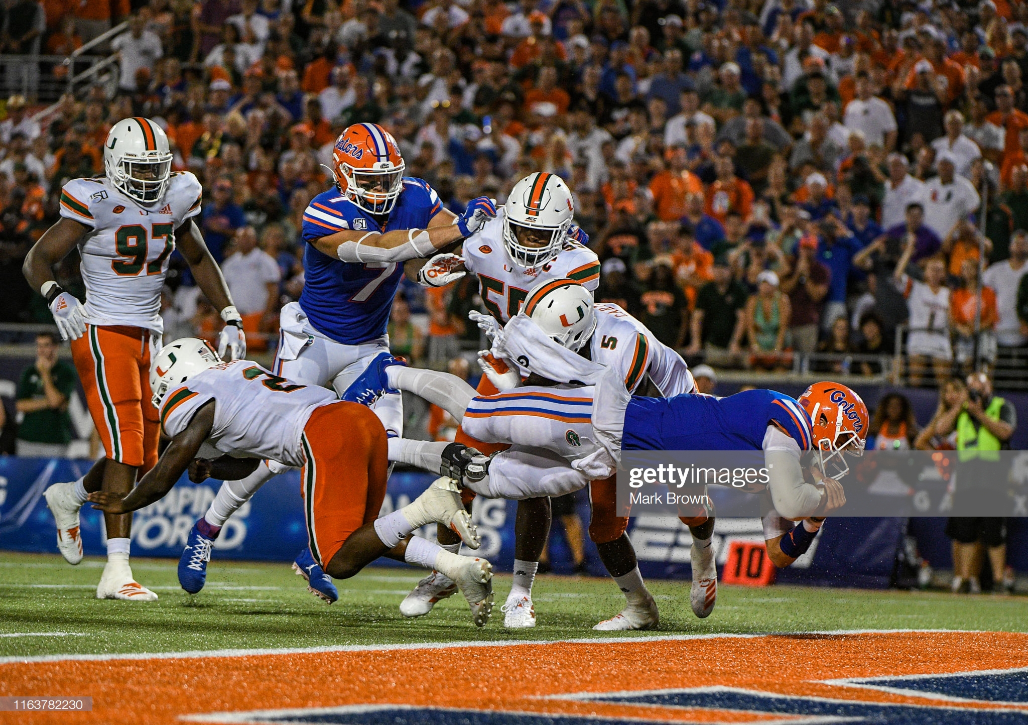 Florida Gators quarterback Feleipe Franks scores a rushing touchdown against the Miami Hurricanes in the 2019 Camping World Kickoff