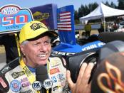 Living legend John Force being interviewed after winning his 150th career race