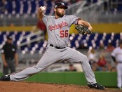 Former Washington Nationals pitcher Greg Holland pitching against the Miami Marlins
