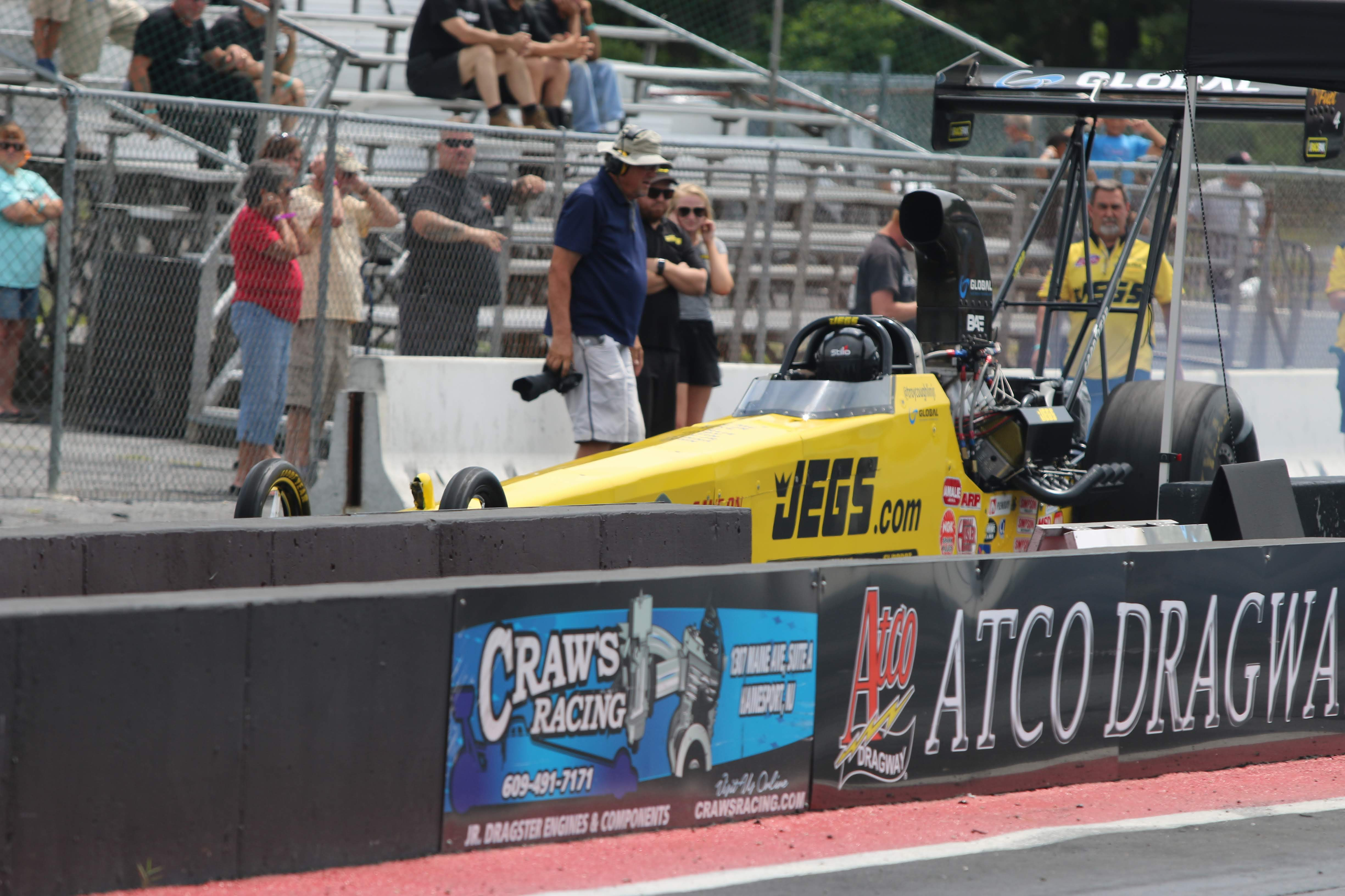 Top Alcohol Dragster Troy Coughlin Jr. readies to do qualifying session one at the NHRA Division at Atco Dragway