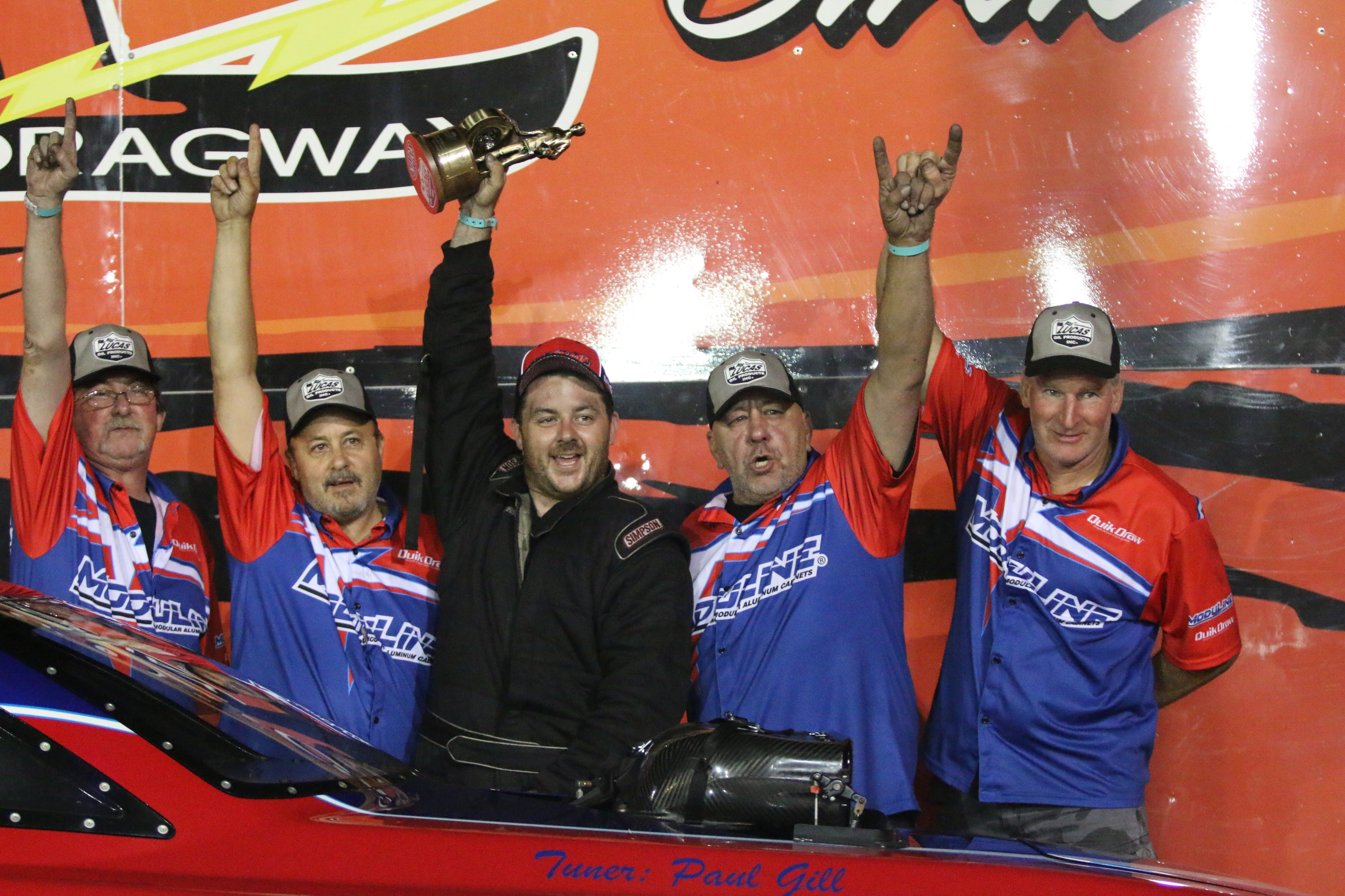 Top Alcohol Funny Car driver Mathew Gill after winning the Wally at the 2019 Atco Divisional
