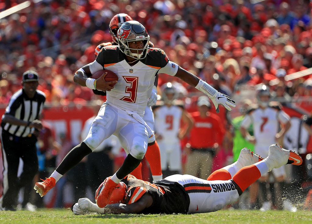 Tampa Bay Buccaneers quarterback Jameis Winston rushing the ball against the Cleveland Browns