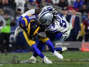 Dallas Cowboys linebacker Jaylon Smith tackles Robert Woods against the Los Angeles Rams in their 2019 NFC Divisional Playoff game