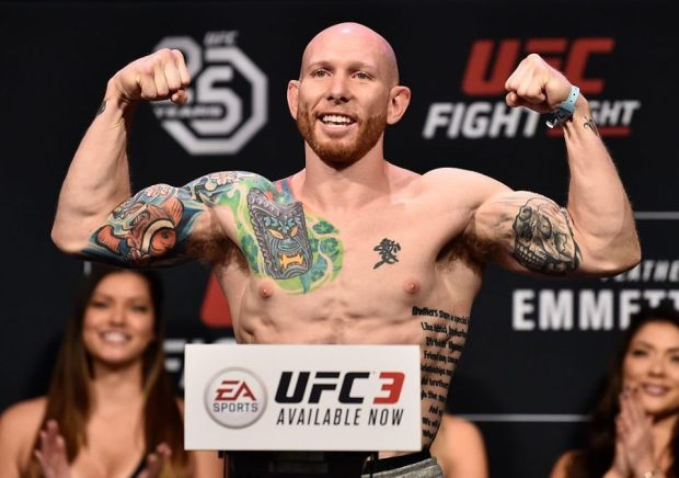 UFC fighter Josh Emmett flexing after a weigh in for one of his fights