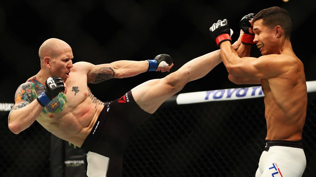 UFC Fighter Josh Emmett kicks Jon Tuck in their Lightweight bout at UFC Fight Night 87