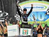 Driver Kevin Harvick celebrates in Victory Lane after winning the Monster Energy NASCAR Cup Series Consumers Energy 400