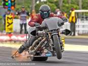 Former Top Fuel Harley rider Mike Scott doing down the track