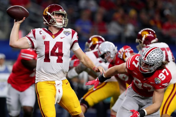 Former Ohio State Buckeyes defensive end Nick Bosa attempts to tackle Sam Darnold against the USC Trojans
