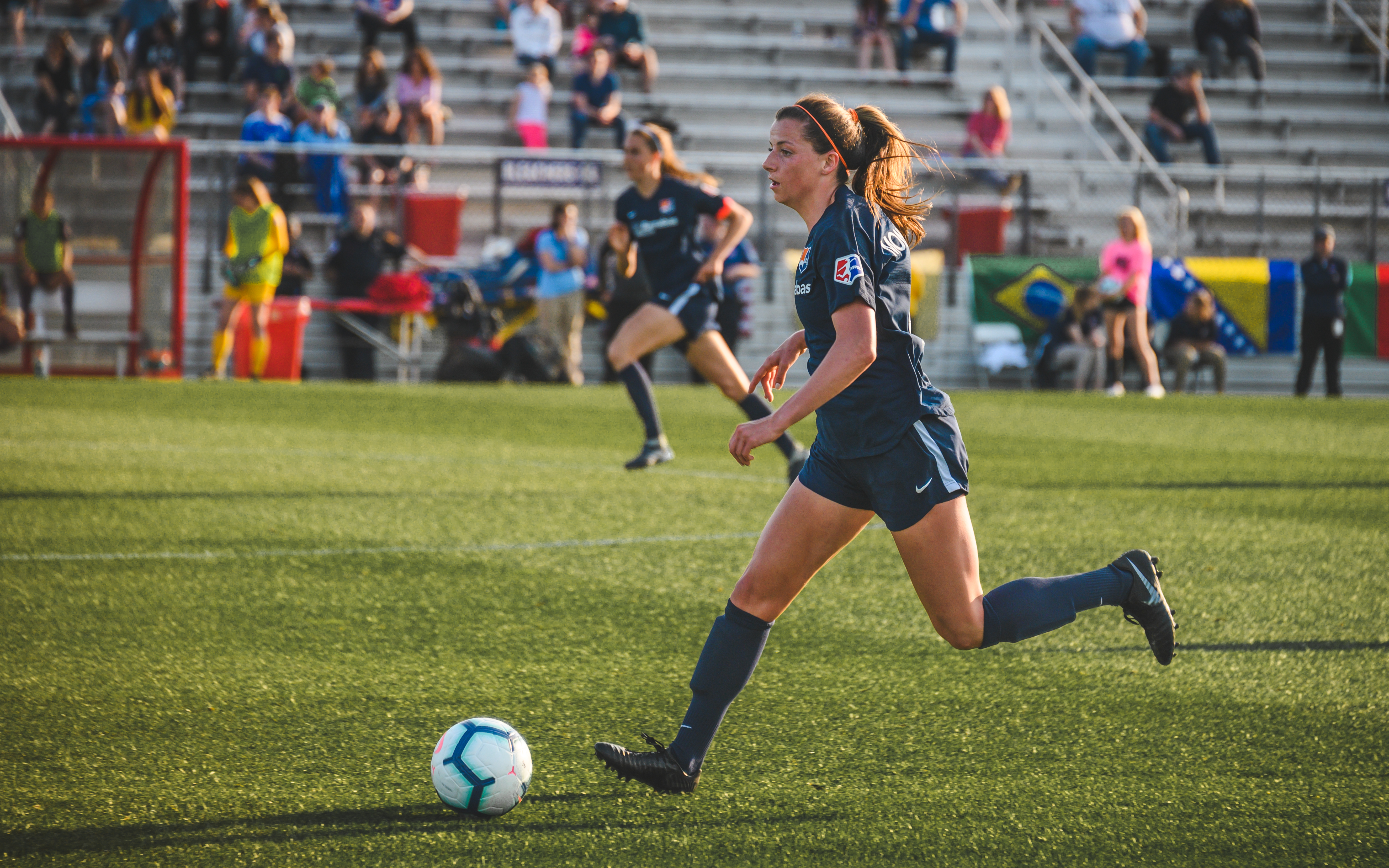 Sky Blue FC forward Paige Monaghan kicking the ball down the field