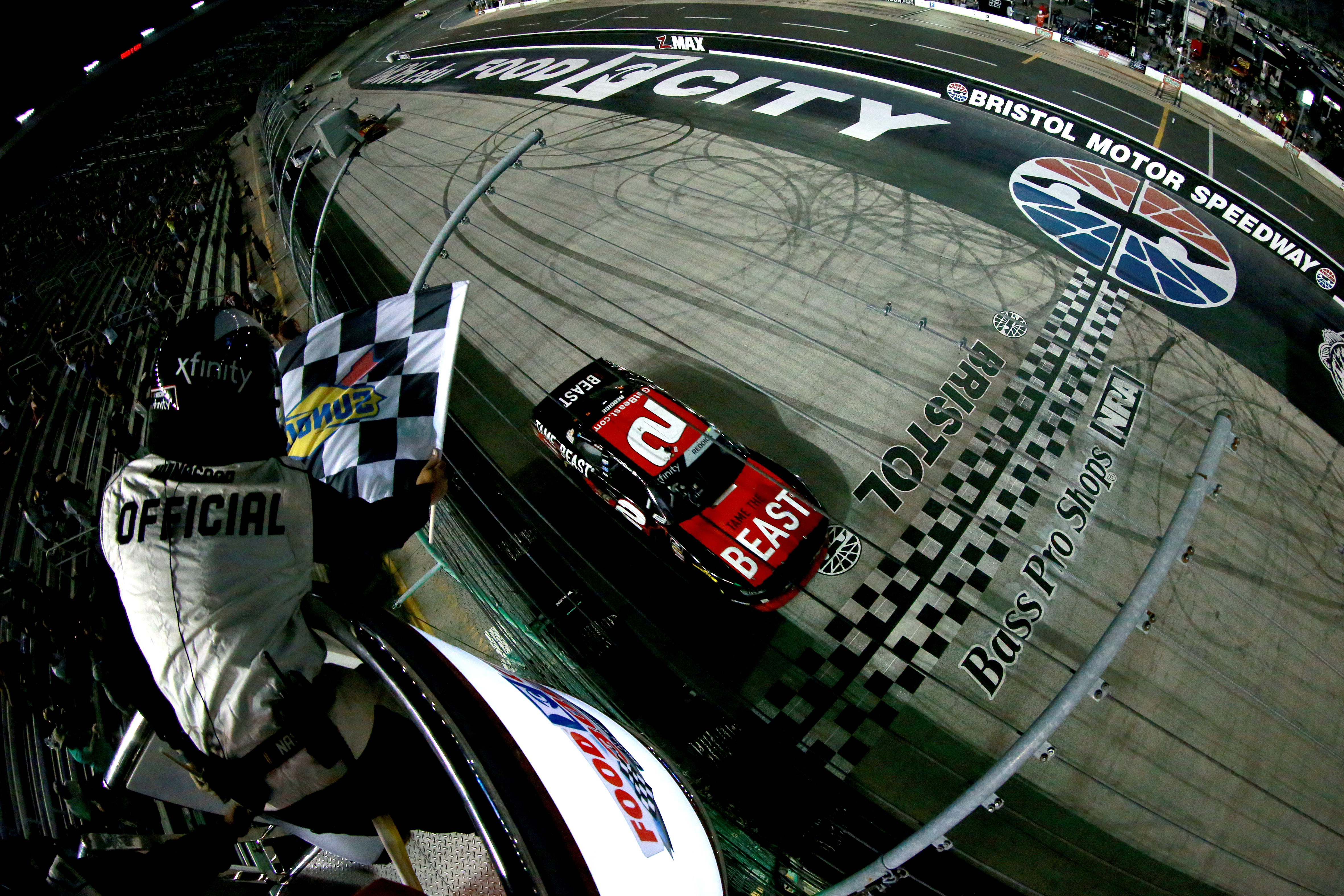 Driver Tyler Reddick takes the checkered flag to win the NASCAR Xfinity Series Foot City 300
