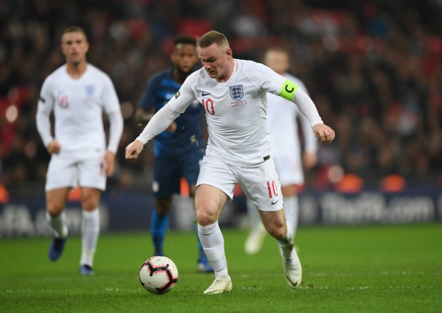 Soccer star Wayne Rooney runs with the ball during an International Friendly between England and the United States