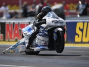 White Alligator Racing Pro Stock Motorcycle rider Jerry Savoie racing on Monday at the Chevrolet Performance U.S. Nationals