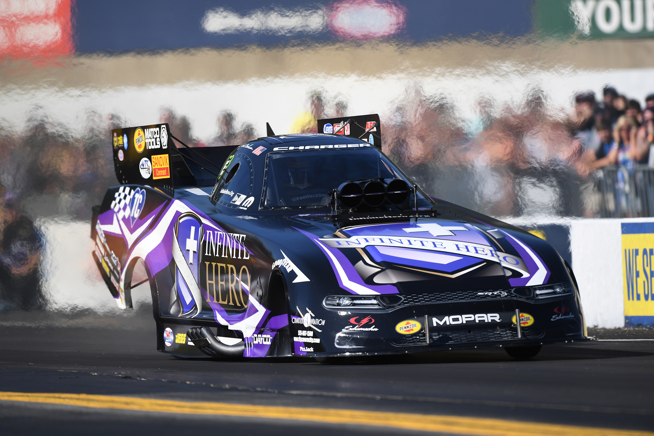 Infinite Hero Foundation Funny Car pilot Jack Beckman racing on Sunday at the Mopar Express Lane NHRA Nationals presented by Pennzoil