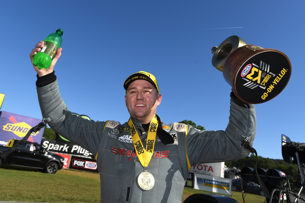 DHL/Kalitta Air Top Fuel Dragster pilot Richie Crampton with the Wally after winning the Mopar Express Lane NHRA Nationals presented by Pennzoil