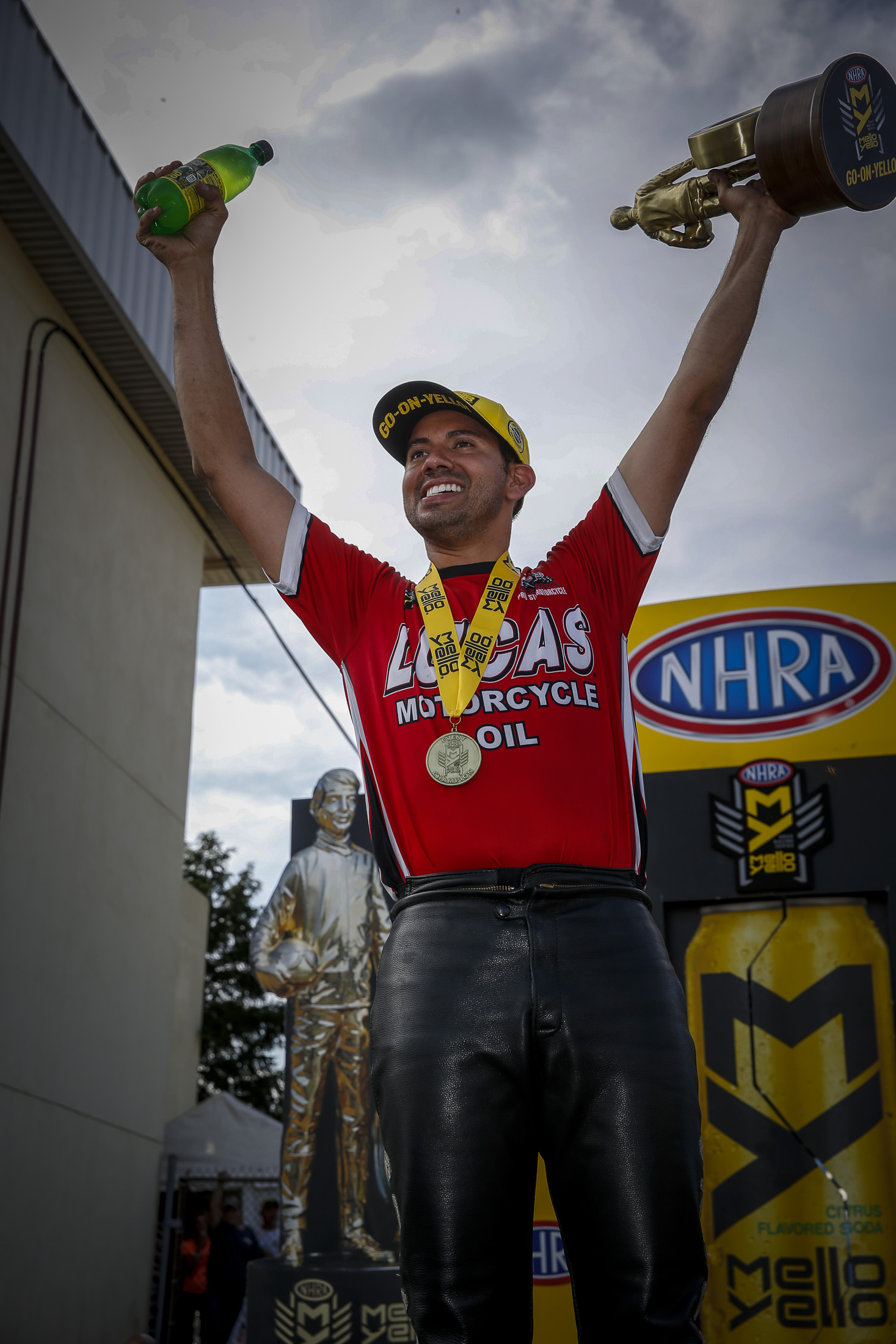 Lucas Oil Pro Stock Motorcycle rider Hector Arana Jr. with the Wally after winning the Dodge NHRA Nationals