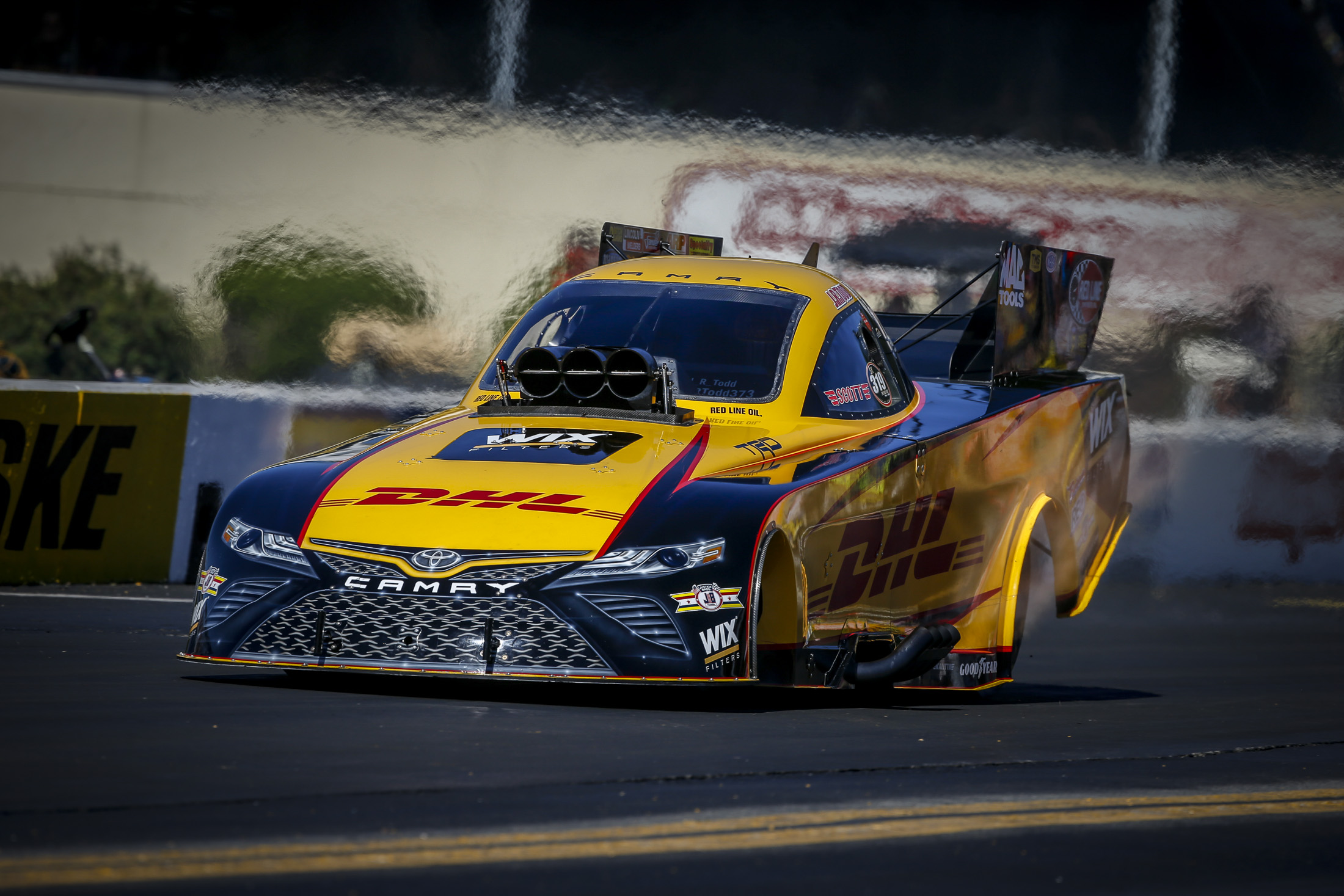 DHL Funny Car pilot J.R. Todd racing on Sunday at the Dodge NHRA Nationals