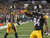 Former Pittsburgh Steelers wide receiver Antonio Brown reacts after scoring a 33-yard touchdown against the Green Bay Packers