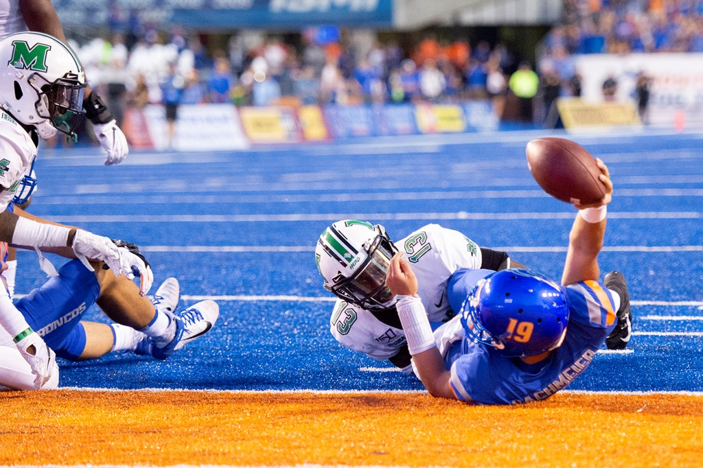 Boise State Broncos quarterback Hank Bachmeier scores a rushing touchdown against the Marshall Thundering Herd