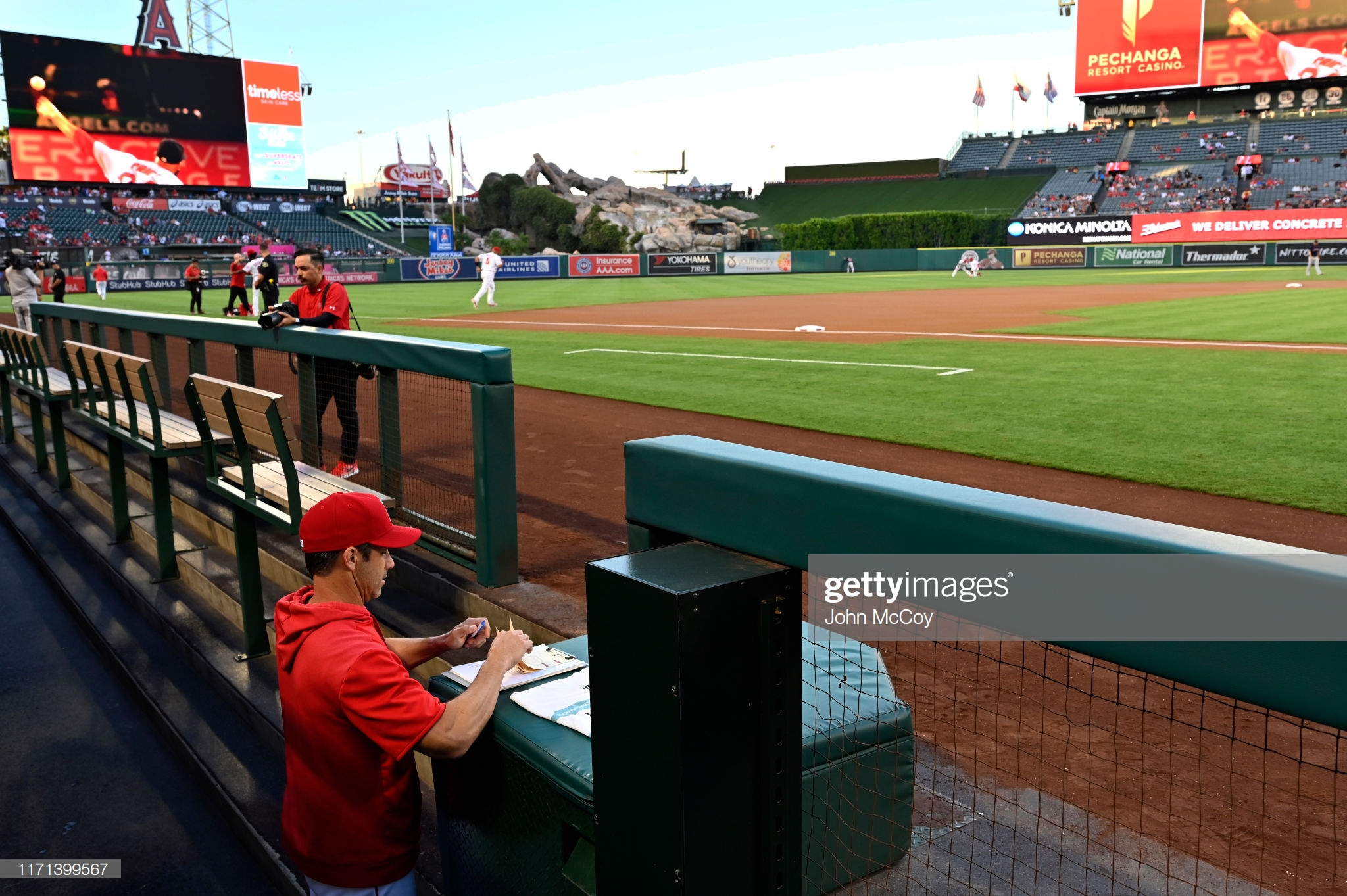 Former Los Angeles Angels manager Brad Ausmus fills out his lineup card before playing the Boston Red Sox