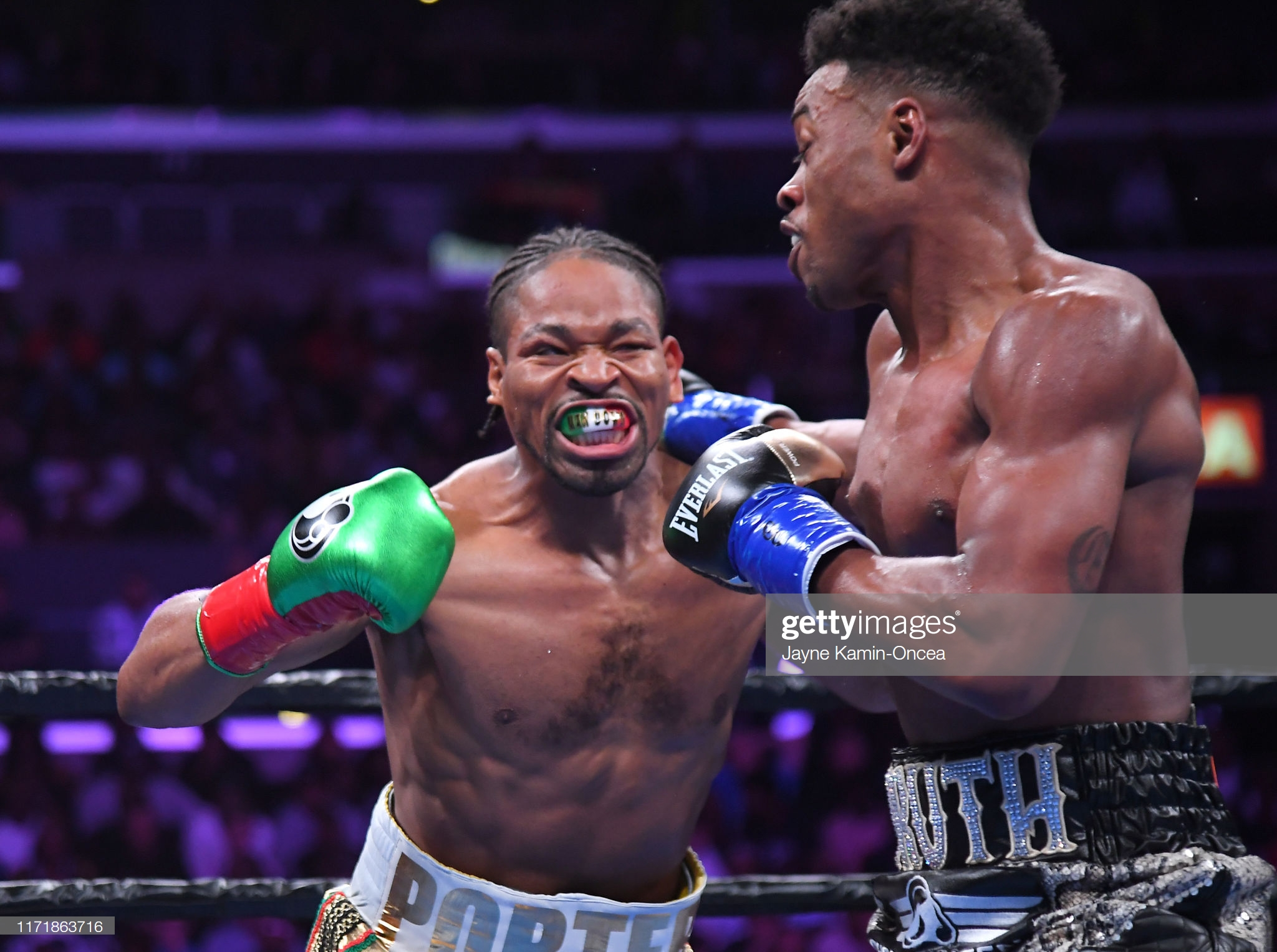 Boxing welterweight Erroll Spence Jr. punches Shawn Porter in the face during their IBF & WBC World Welterweight Championship fight