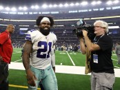 Dallas Cowboys running back Ezekiel Elliott smiles as he walks off the field following a win against the Jacksonville Jaguars