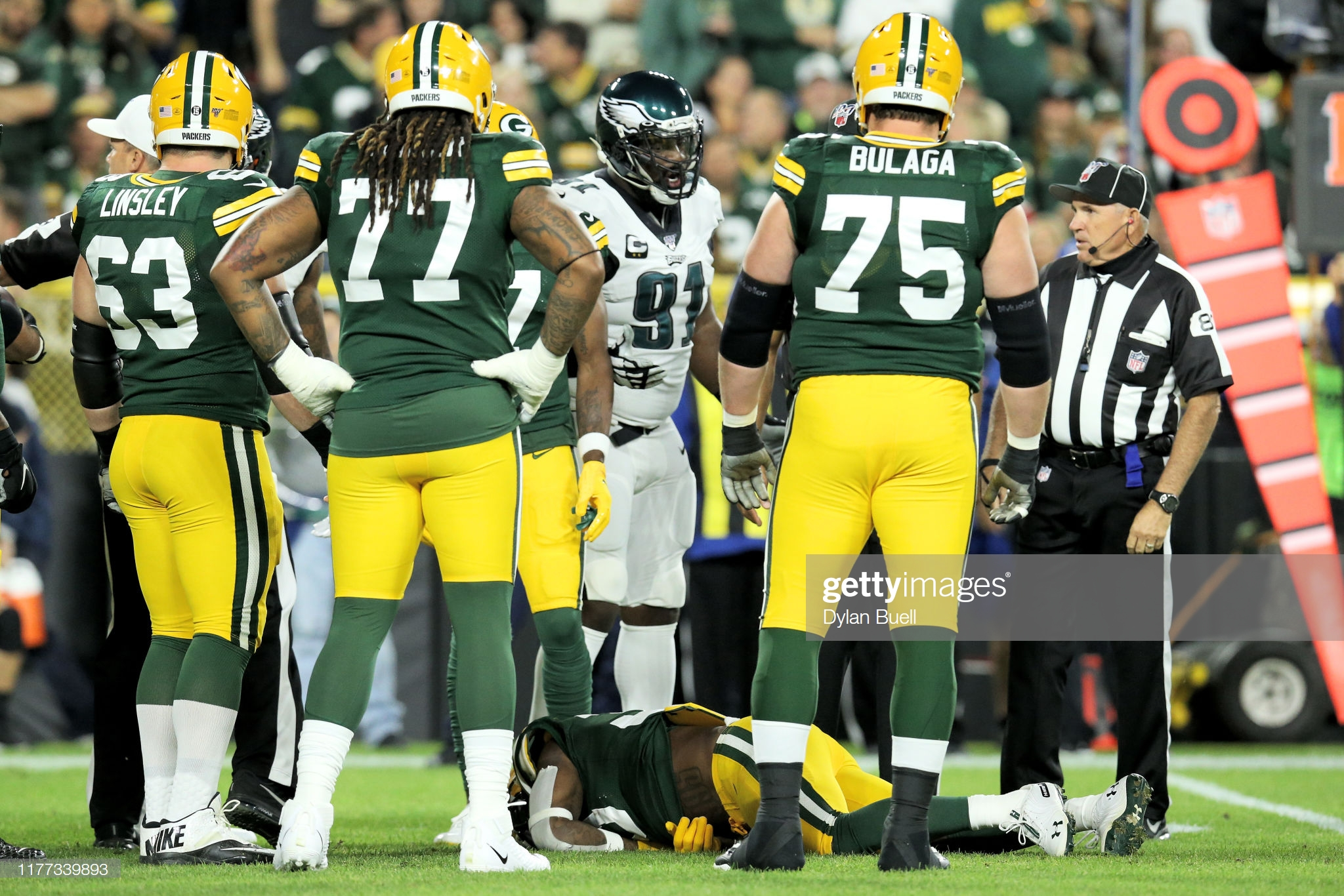 Green Bay Packers running back Jamaal Williams lays on the field after being injured from a hit against the Philadelphia Eagles
