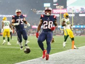 New England Patriots running back James White scores an eight-yard rushing touchdown against the Green Bay Packers