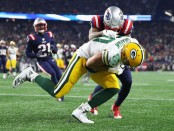 Green Bay Packers tight end Jimmy Graham catches a touchdown reception as Patrick Chung attempted to defend the pass against the New England Patriots