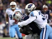 Former Tennessee Titans safety Johnathan Cyprien tackles Rob Gronkowski against the New England Patriots