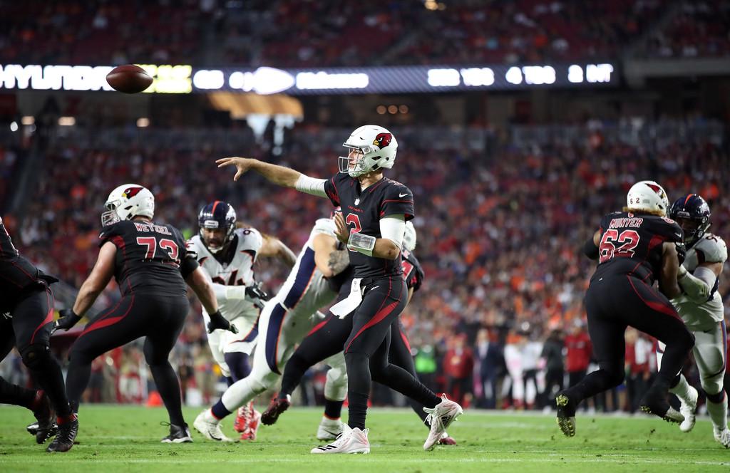 Former Arizona Cardinals quarterback Josh Rosen attempting a pass against the Denver Broncos