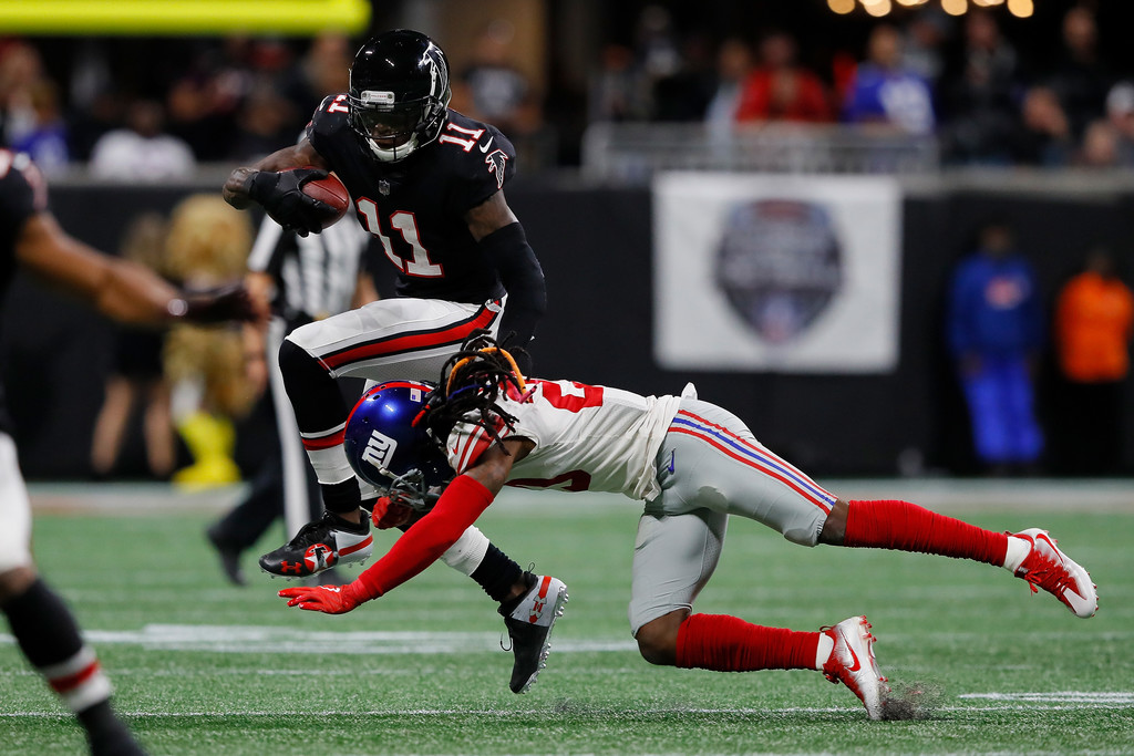 Atlanta Falcons wide receiver Julio Jones is tackled by Janoris Jenkins against the New York Giants
