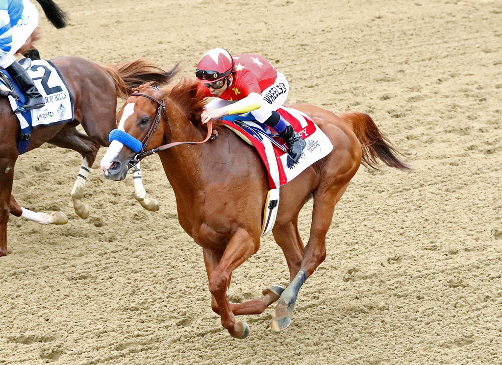Justify, ridden by jockey Mike Smith, wins the 150th running of the Belmont Stakes at Belmont Park