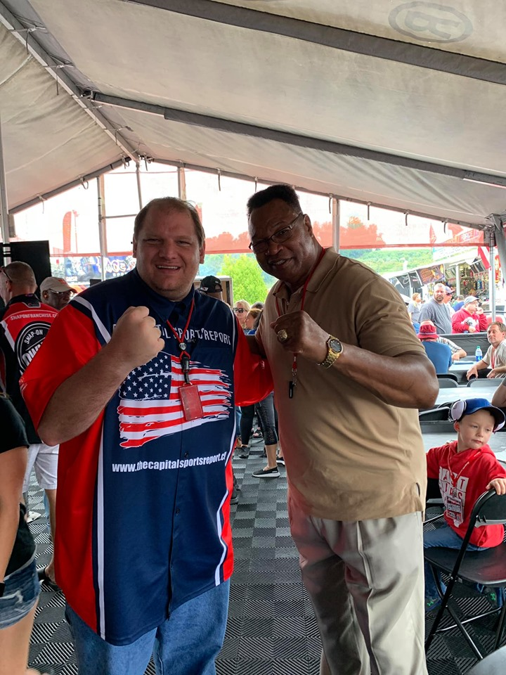 Boxing legend Larry Holmes with our Publisher Anthony Caruso III with the fists