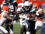Los Angeles Chargers running back Melvin Gordon runs the ball against the Cleveland Browns