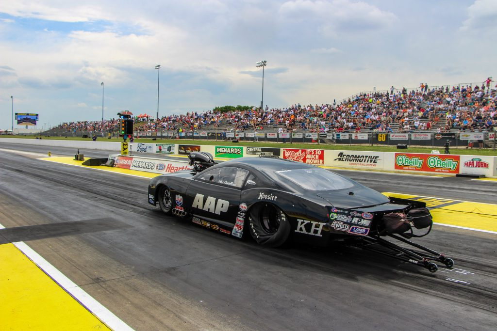 Driver Mike Castellana driving his Pro Mod at an NHRA race